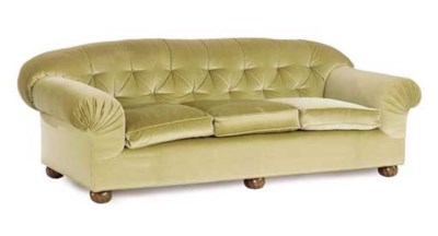 AN OLIVE VELOUR UPHOLSTERED CL