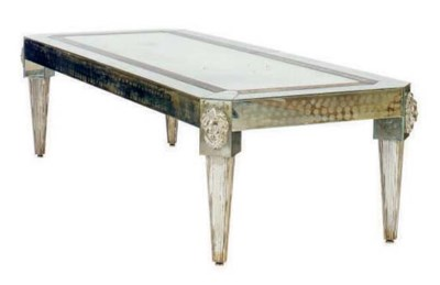 A MIRRORED LOW TABLE WITH CAST