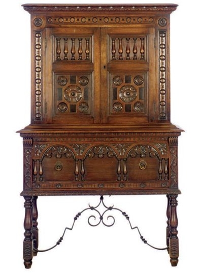 A CARVED OAK AND WROUGHT IRON
