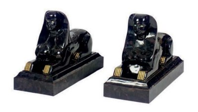 A PAIR OF STONE AND BRASS MOUN