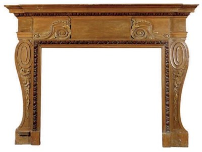 A CARVED WOOD FIREPLACE SURROU