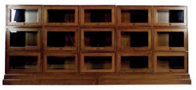 A LARGE OAK AND GLASS BOOKCASE