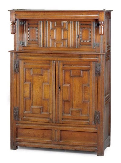 AN ENGLISH OAK PRESS CUPBOARD,