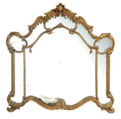A ROCOCO STYLE CARVED GILTWOOD