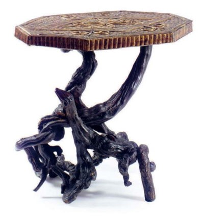 A RUSTIC TWIG AND ROOT TABLE,