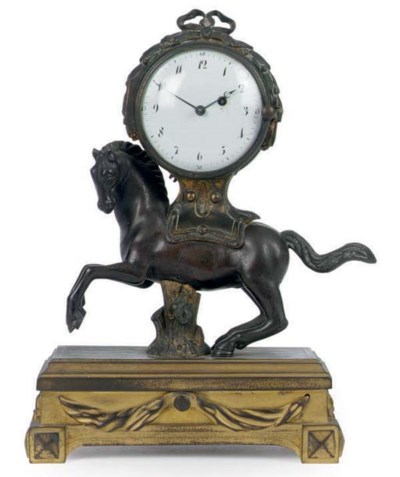 A FRENCH GILT-METAL AND PATINA