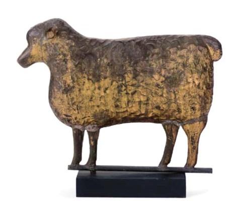 A GILT MOLDED COPPER SHEEP WEA