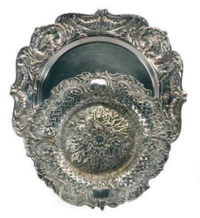 A SET OF TWELVE SILVER-PLATED