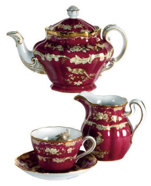 AN ENGLISH BONE CHINA POWDERED FUSCHIA-GROUND PART TEA SERVICE,