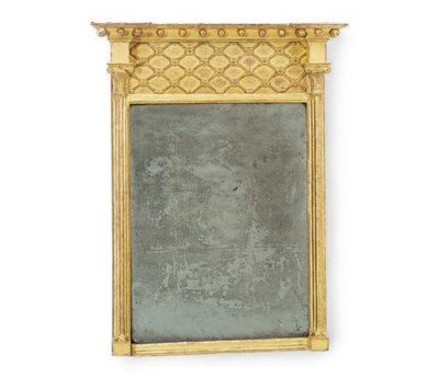 A REGENCY GILTWOOD MIRROR WITH