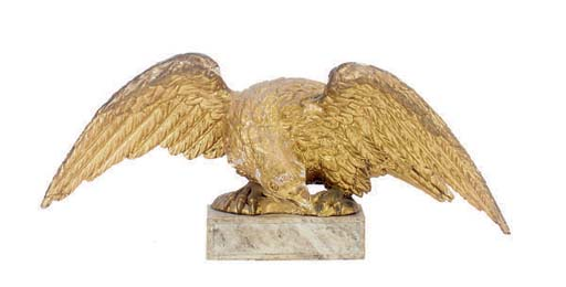 A CARVED GILTWOOD EAGLE,