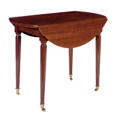 A MAHOGANY DROP-LEAF TABLE ON