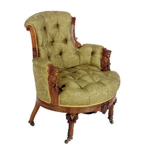 A ROSEWOOD ARMCHAIR**,
