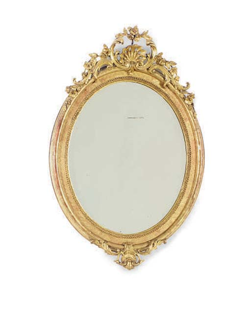A FRENCH GILTWOOD OVAL FRAME M