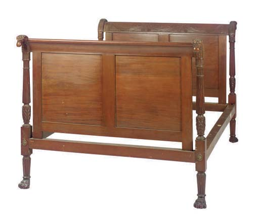 A CARVED MAHOGANY BED FRAME,