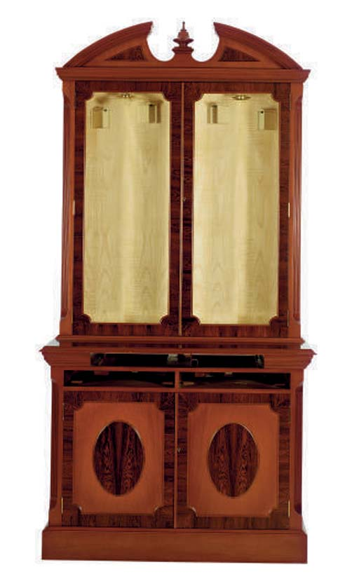 A TWO-PART MAHOGANY GUN CABINE