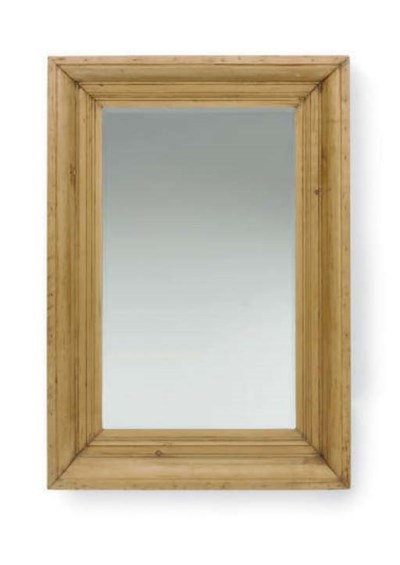 A PINE FRAMED BEVELED GLASS WA