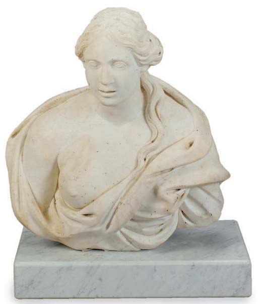 A CARVED STONE BUST OF A WOMAN
