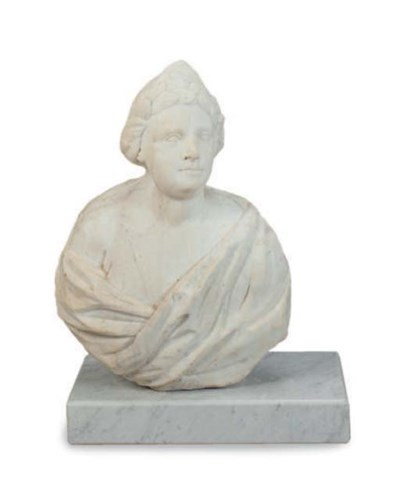 A CARVED STONE BUST OF A MAN,