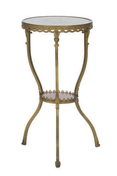 A GILT-METAL AND ROUGE MARBLE