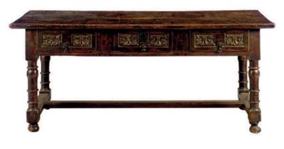 A SPANISH CARVED WALNUT TABLE,
