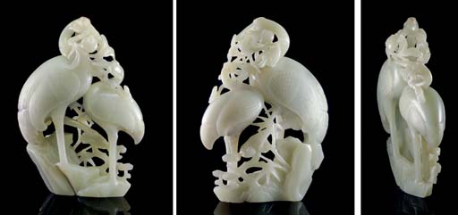 A WHITE JADE CARVING OF TWO CR