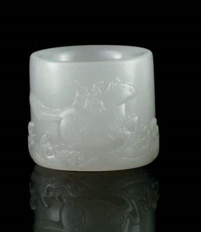 A WHITE JADE THUMB RING