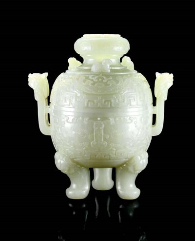 A LARGE WHITE JADE ARCHAISTIC