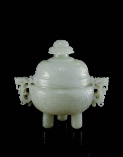 A GREENISH-WHITE JADE ARCHAIST