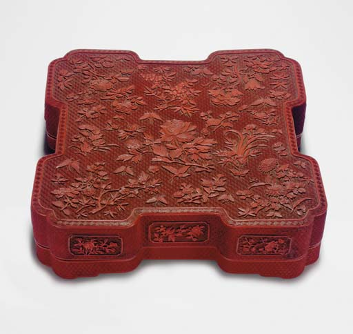 AN UNUSUAL LARGE CARVED RED LA
