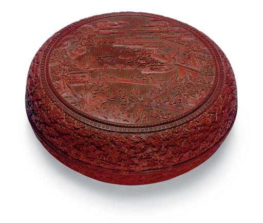 A LARGE CARVED RED LACQUER CIR