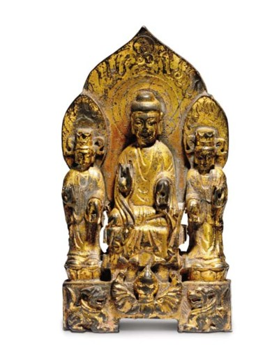 A RARE GILT-BRONZE BUDDHIST TR