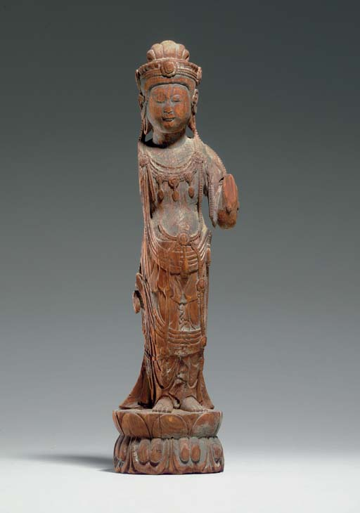 A RARE CARVED WOOD FIGURE OF A
