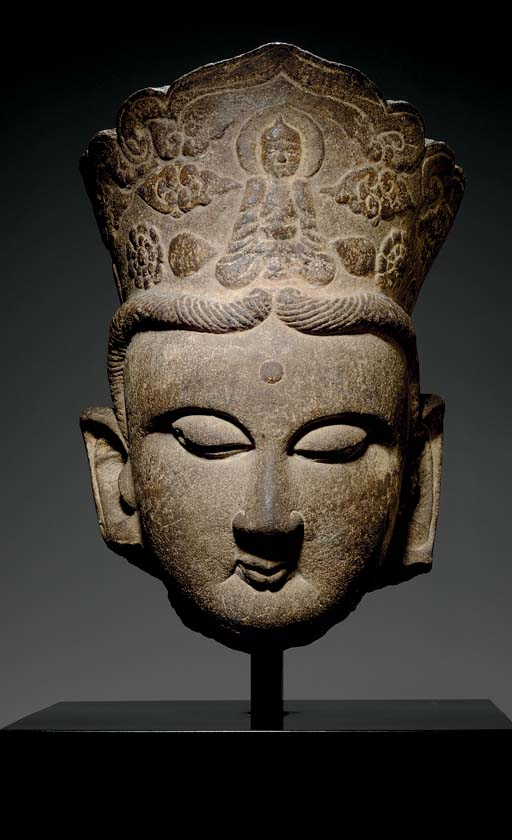 A LARGE STONE HEAD OF A BODHIS