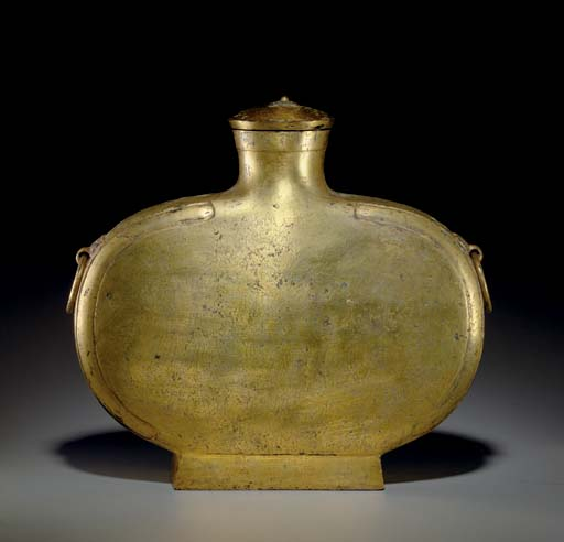 AN UNUSUAL INCISED GILT-BRONZE