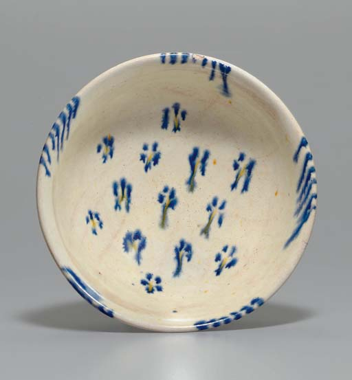 A BLUE AND AMBER-GLAZED POTTER