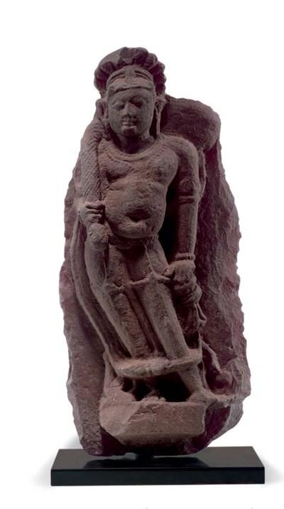A red sandstone figure of a de