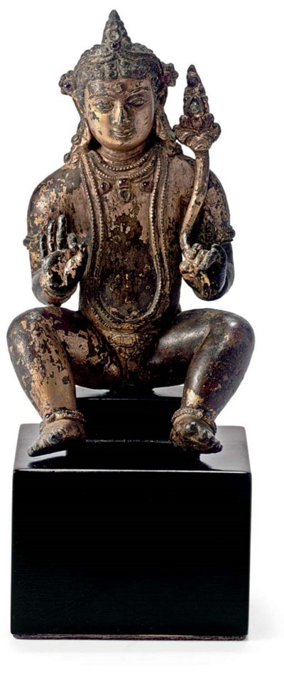 A gilt copper figure of Kubera