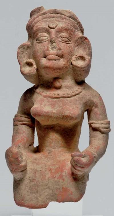 A terracotta figure of a woman