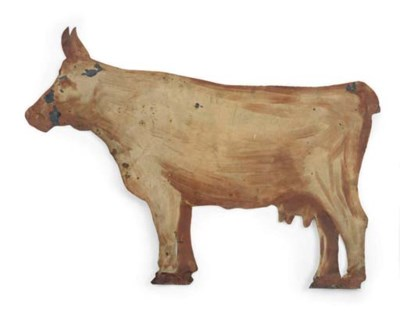 A PAINTED CUT-TIN COW TRADE SI