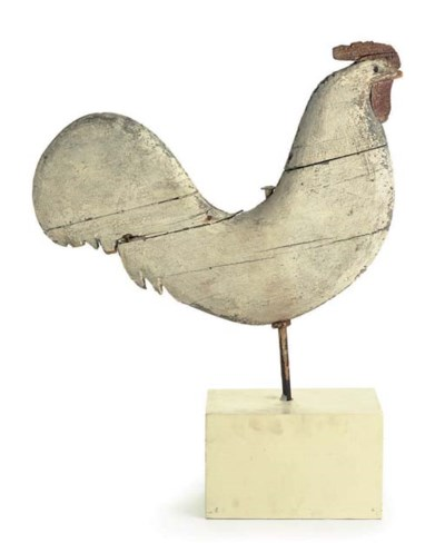 A CARVED AND PAINT-DECORATED W