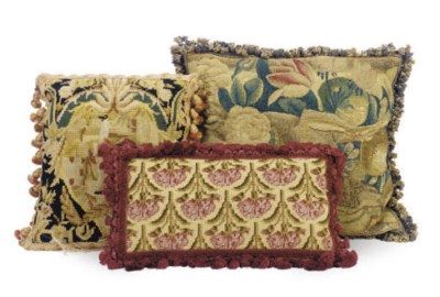 A GROUP OF SIX PILLOWS,