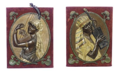 A PAIR OF PATINATED AND POLYCH