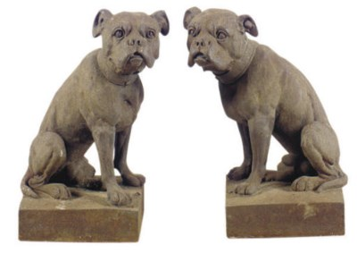 A PAIR OF CAST IRON BULL DOGS,