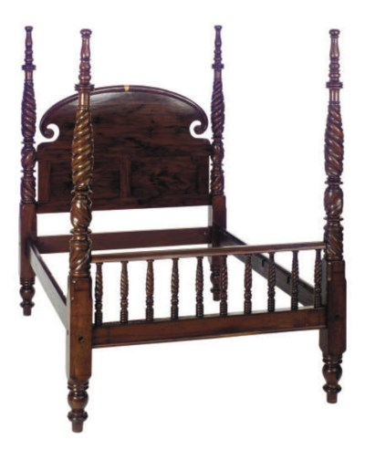A CARVED MAHOGANY FOUR-POSTER