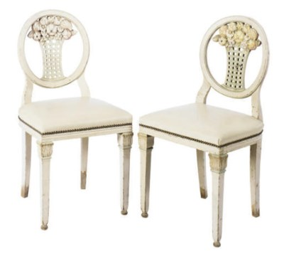 A SET OF FOUR SIDE CHAIRS WITH