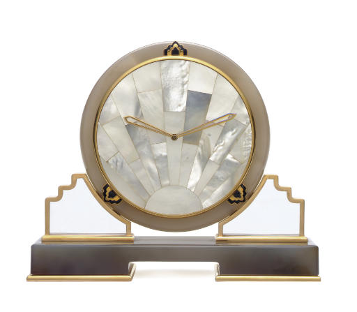 A ROCK CRYSTAL, AGATE, MOTHER-OF-PEARL AND BLACK ENAMEL TABLE CLOCK, BY CARTIER