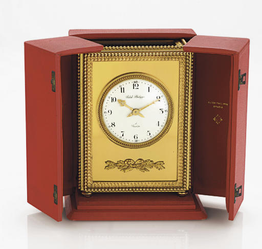 PATEK PHILIPPE.  A GILT-BRASS SOLAR-POWERED MANTEL CLOCK