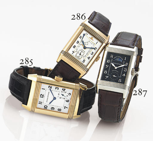 JAEGER-LECOULTRE. AN 18K WHITE GOLD RECTANGULAR REVERSIBLE DOUBLE DIALED WRISTWATCH WITH NIGHT AND DAY INDICATION