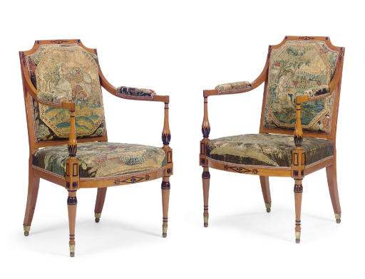 A PAIR OF GEORGE III SATINWOOD AND PARCEL-EBONIZED OPEN ARMCHAIRS